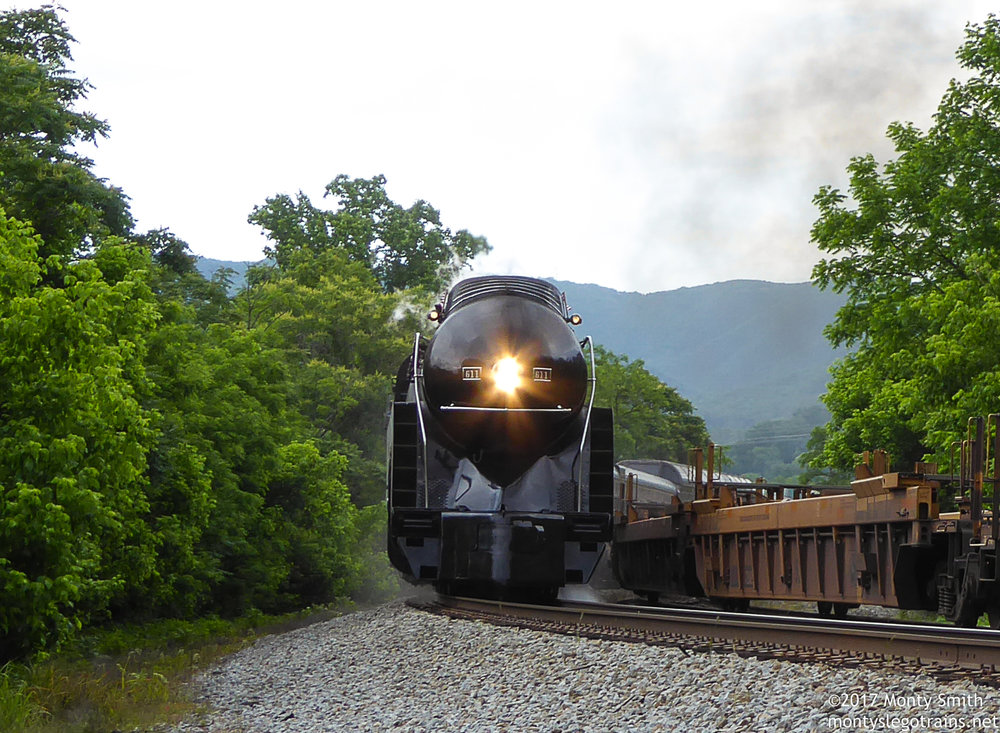 N&W 611 charges upgrade alongside Norfolk Southern train 29G.