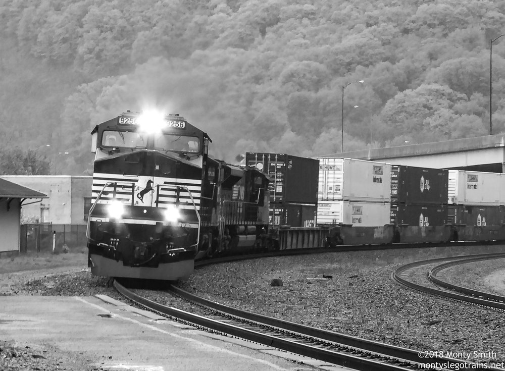 An unidentified intermodal train leans into the curve at Tyrone, PA