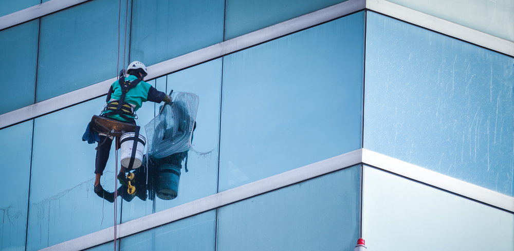 person cleaning a window