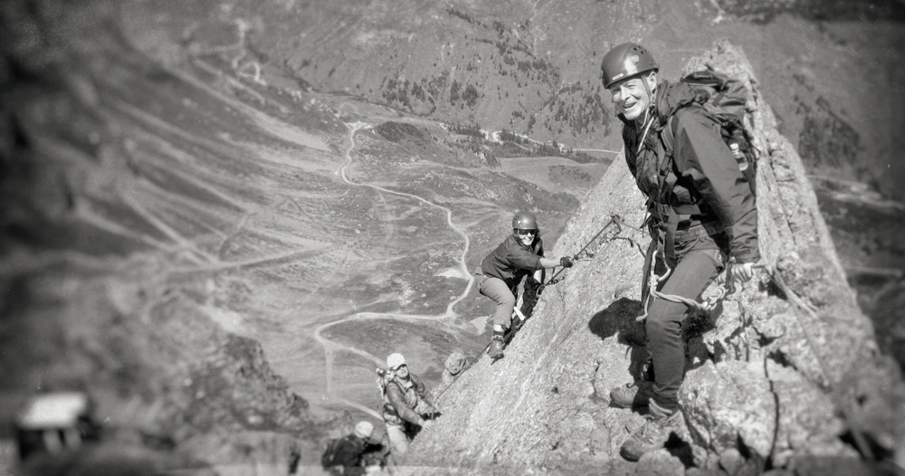 Kenny Sinclair and team clipped in to a Via Ferrata in the Dolomites, Italy