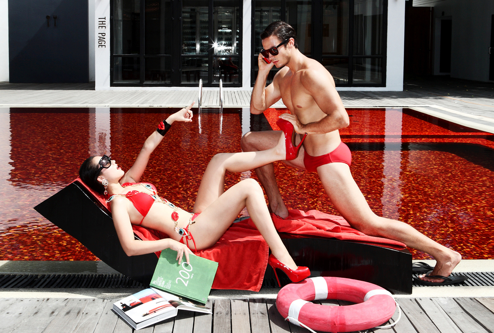 Swimwear by The Library / Sunglasses by PRADA / Accessories by Butler & Wilson London