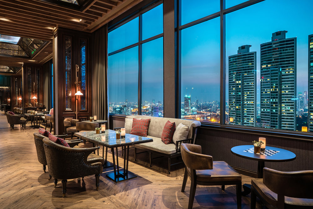 On the 37th floor of Bangkok Marriott Marquis Queen's Park, high above the city streets, ABar transports guests into a bygone era. With classical dark wooden décor, wingback chairs and leather-bound books, this cool sophisticated cocktail bar blends the mystery and magic of Victorian London with the gritty edge of 1930s America. This makes ABar the perfect spot in which to unwind and enjoy creative, hand-crafted cocktails in a cozy ambience overlooking the spectacular Bangkok skyline. Guests can unwind with their new favorite beverage or reimagined classic in a sanctuary of high-end relaxation with a cool jazz soundtrack. Seating is offered either in the warm indoor snug or on the semi-al fresco terrace which overlooks Benjasiri Park.