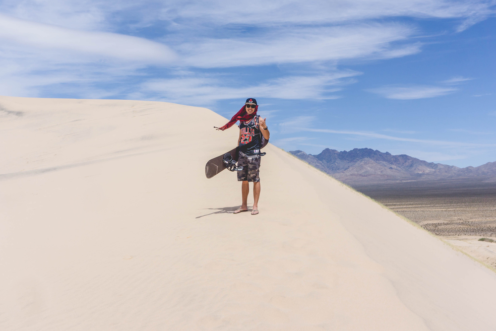 Carrying my board on the gnarly trek was no joke but totally worth it.