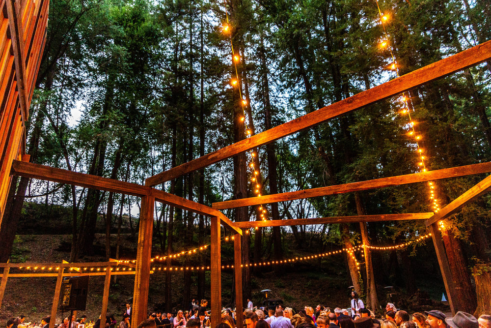 The illuminated structure of the Redwood Pavilion at The Brambles in Philo, Anderson Valley, California