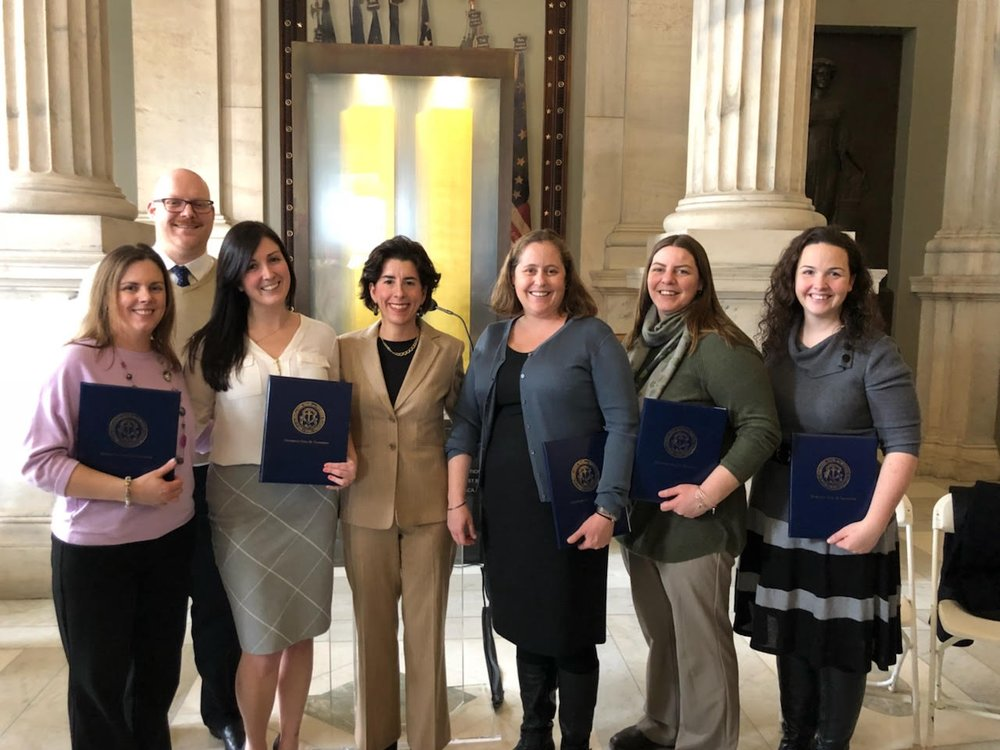 Foster America fellow Adam Williams and colleagues from the Rhode Island Department of Children, Youth, & Families receive the Rhody Service Award from Governor Gina Raimondo