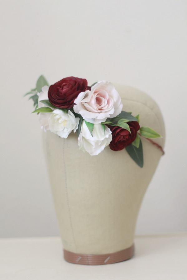 A collection of burgundy, blush pink and cream blooms with added greenery.