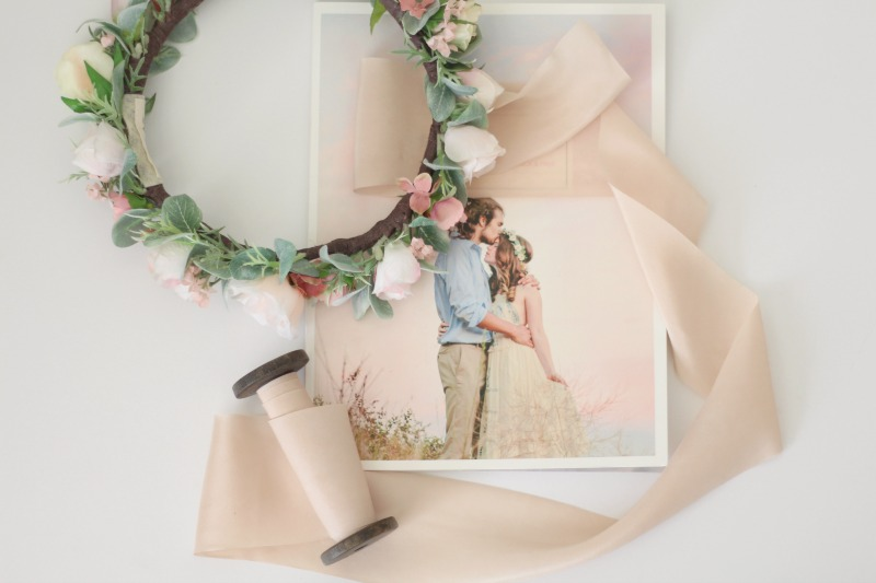 This crown of blush pink, cream and eucalyptus was created for a sweet flower girl.