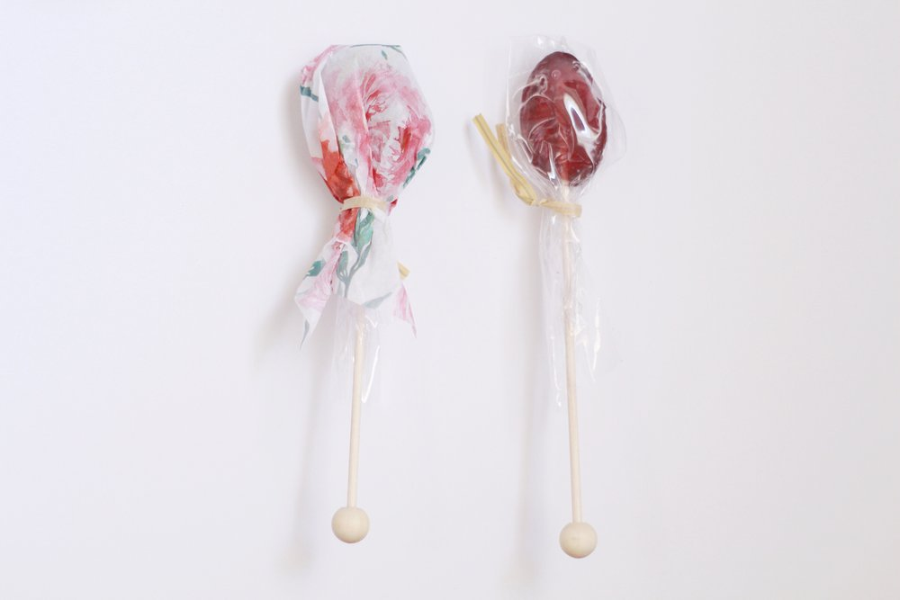 A  tip for adding for cohesion to your gifts  is re-wrapping items in coordinating tissue paper like these  Lavender Honey Spoons . The one on the right is the original packaging. I added floral tissue paper around the top to pretty it up a bit.