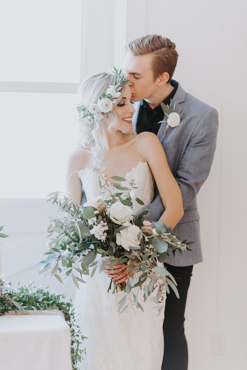 Winter wedding bridal style with flower crown hairstyle. White and greenery floral crown by Love Sparkle Pretty.