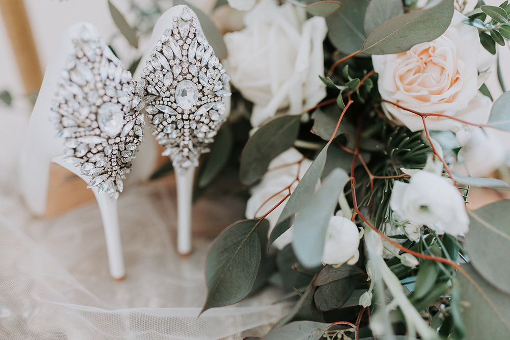 winter wedding bridal style with greenery details and gorgeous beaded bridal shoes.