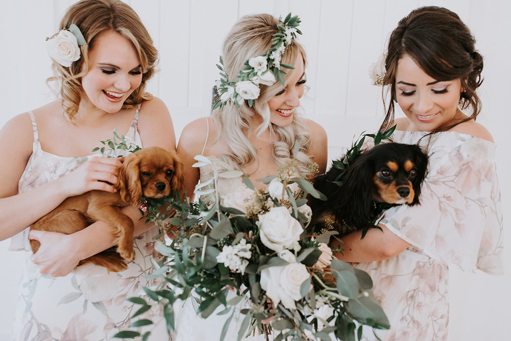 Winter wedding bridesmaids style with flower crownand puppies. White and greenery floral crown by Love Sparkle Pretty.