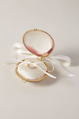 - This Seashell Ring Holder by Seashell Collection may be small but it is so sweet! Instead of the traditional pillow, opt for this unique ring holder and then keep it as an heirloom piece for your jewelry. It will serve as a daily reminder of the day you said your vows.