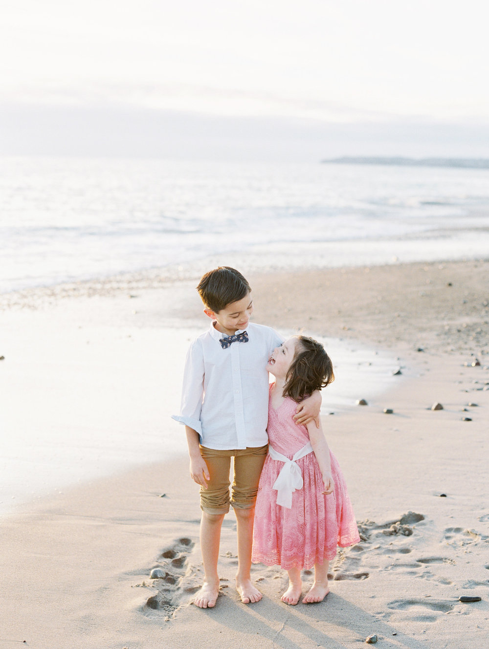 family photo session on the beach. cute sibling photo. Love Sparkle Pretty blog. photo by Mallory Dawn