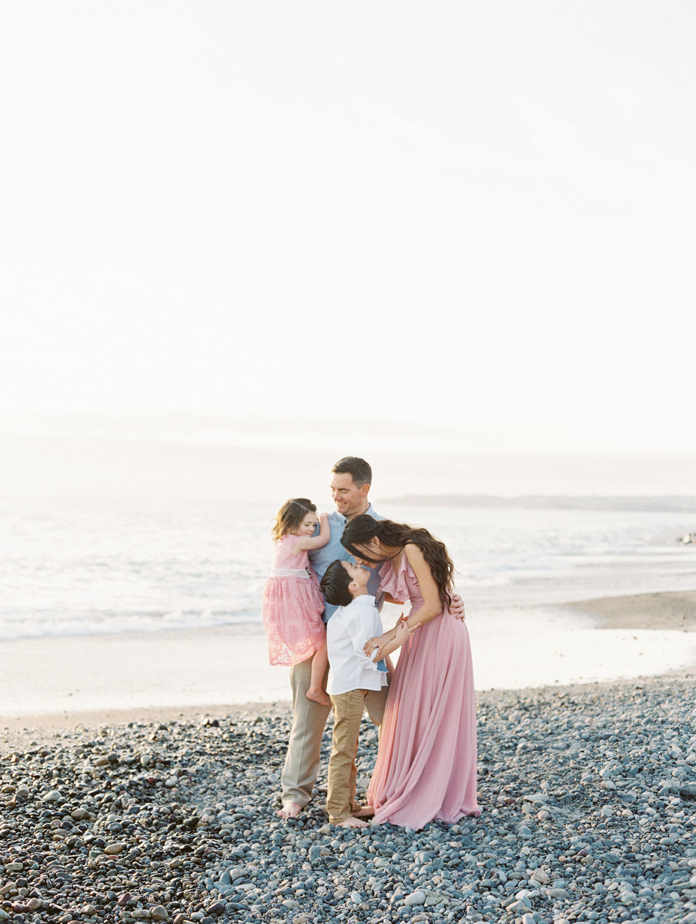 family photo session on the beach with Love Sparkle Pretty. Photo by Mallory Dawn