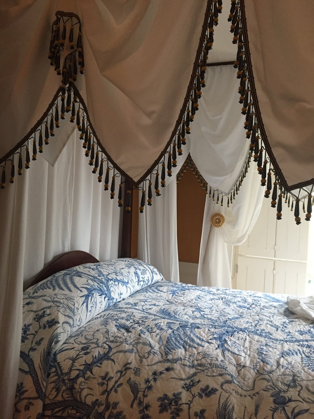 Georgian style four poster bed with upholstery hangings for ornate and warmth purposes.