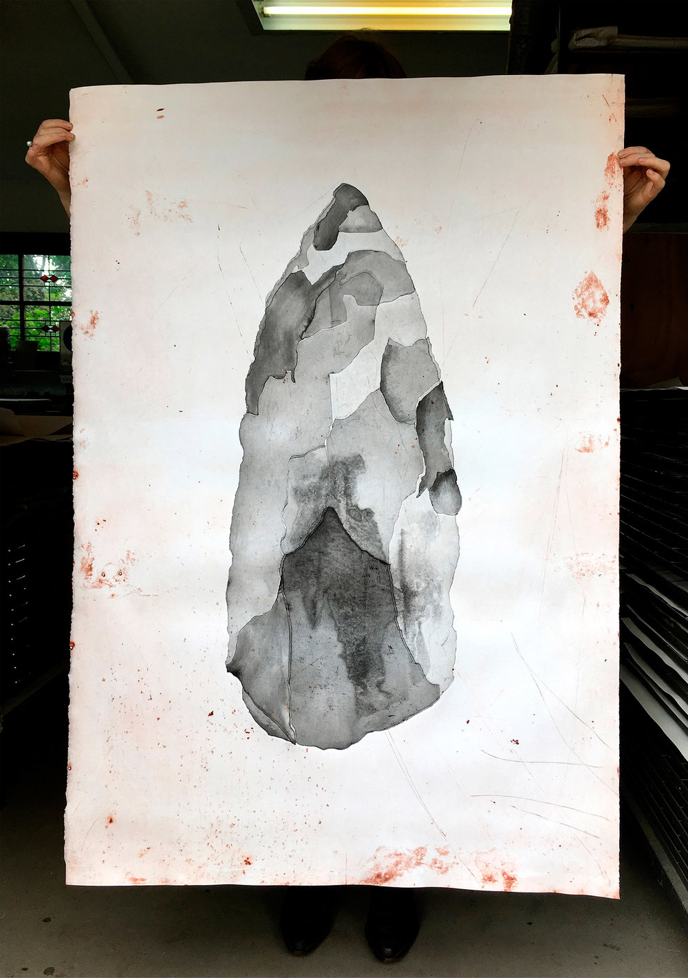 Print Test Stone Spear Tip 2016 size: 135 x 95cm. First monotype prints made at Basil Hall's print studio in Braidwood NSW 2016. Each stone shard is a separate plate, cut, inked and pressed through the printing press. The textured background (scratches) is the imprint of a large metal sheet that I found lying in the bush, worn from exposure to the harsh Kimberley environment for a long period of time.