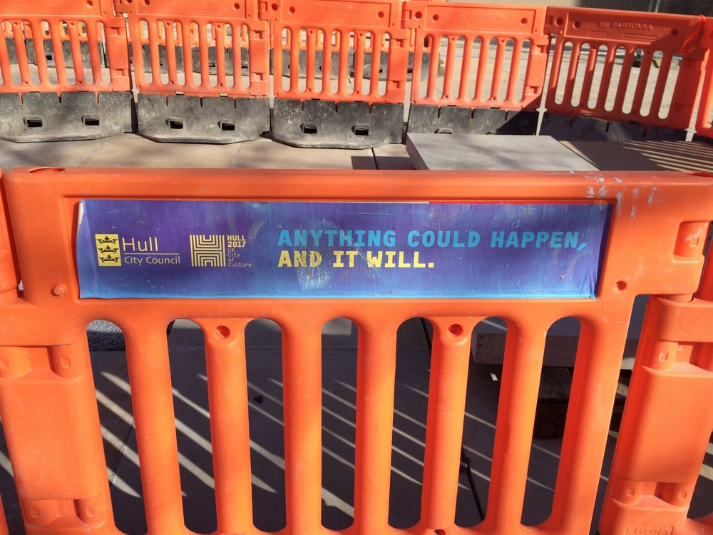 The taglines can be spotted throughout the city, like on these all-too-familiar orange barriers