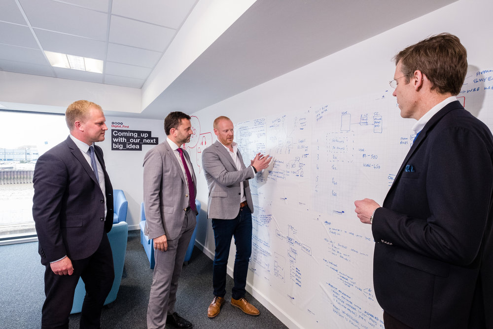 Arco's Digital Director Richard Martin explains the company's Digital First programme to Wykeland Group's Dominic Gibbons and John Gouldthorp, left, watched by Arco Chief Executive Neil Jowsey.