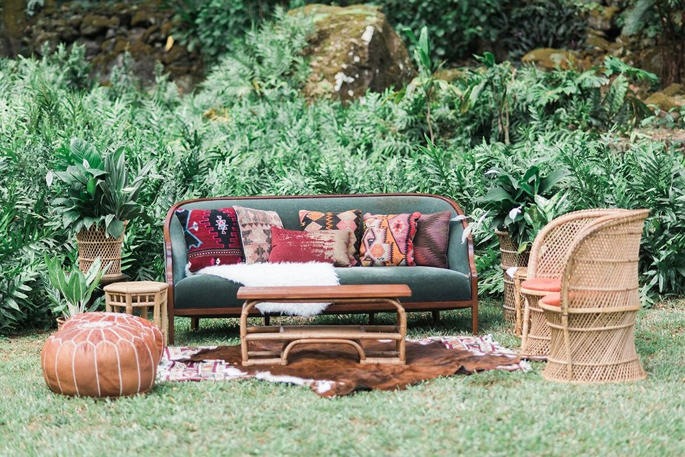Emerald Velvet Sofa and Vintage Rattan Chairs ;  Pillows and Rugs  Photo by:  Rae Marshall Photography