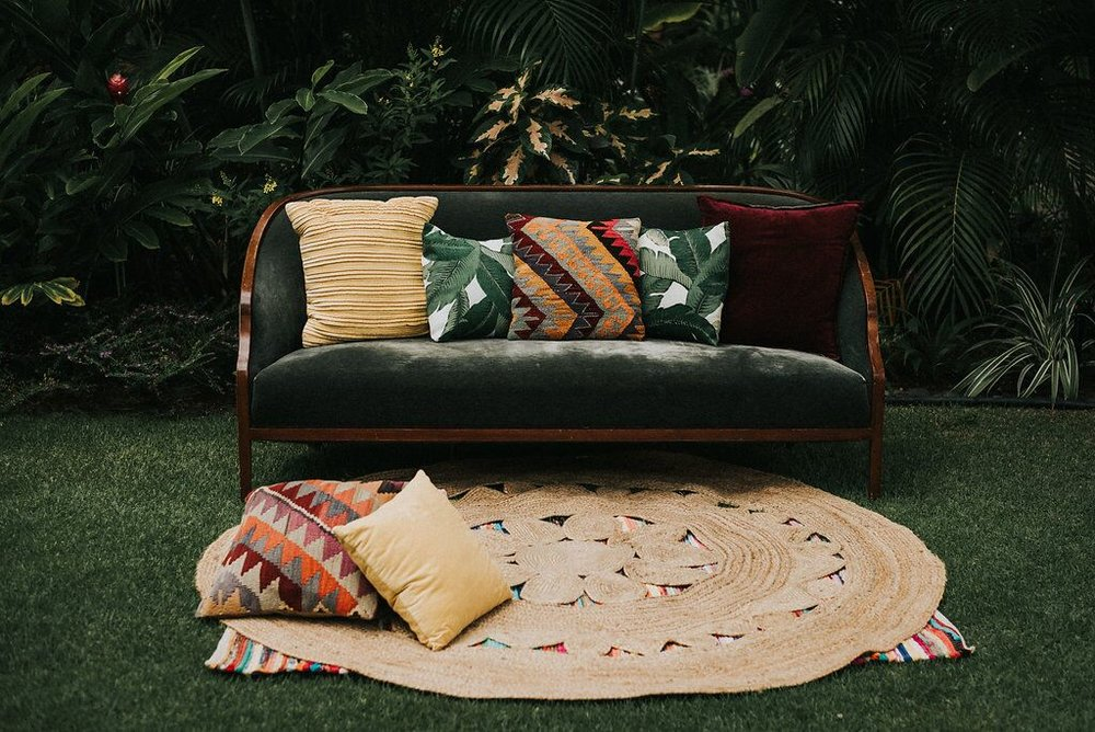 Emerald Velvet Sofa ,  Round Jute Rug ,  Indian Chindi Rug ,  Select Pillows   Photo By:  Gabriella Katalin
