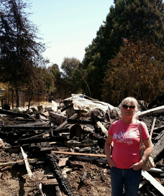 Elaine standing in burned down town of Lower Lake, CA.                                         We assisted both victims and responders.