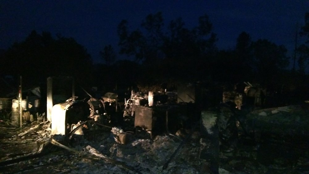 Photo taken after dark by Pastor Lee of burnt house that he and Elaine had built 35 years ago in now fire ravaged area of Redwood Valley, CA