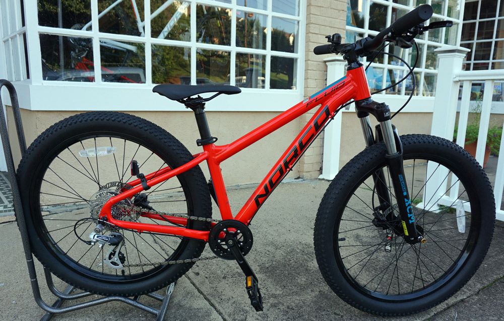"Norco Fluid 24 - Reg $600, SALE $480. Perfect 24+ bike for your little ripper. Hydraulic brakes and a Suntour boost 24"" fork"