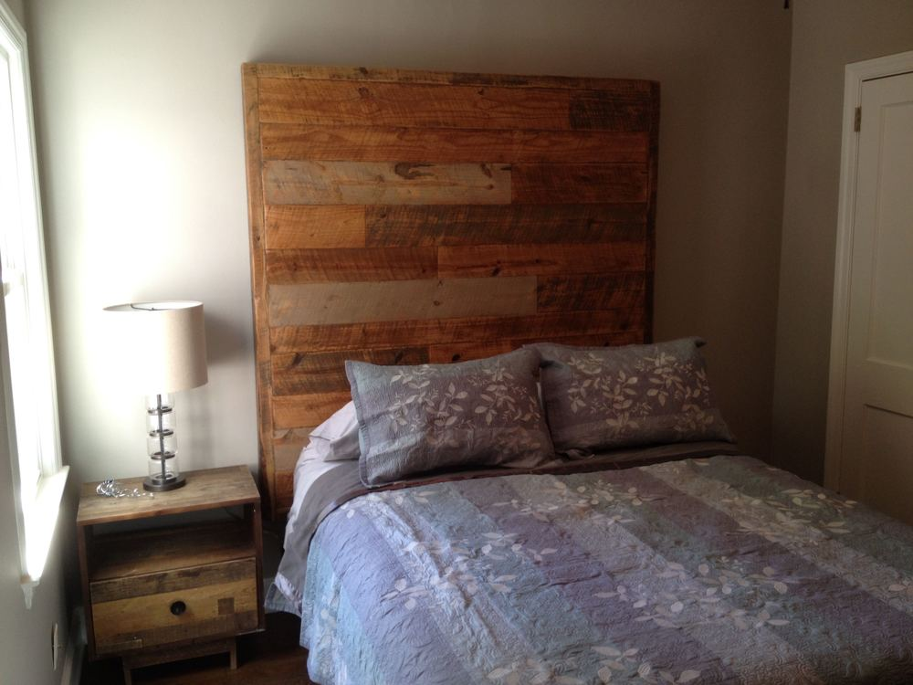 "Staggered Plank Queen Headboard       66"" tall x 66"" wide x 4"" thick    Multi stain finish   $1,595"