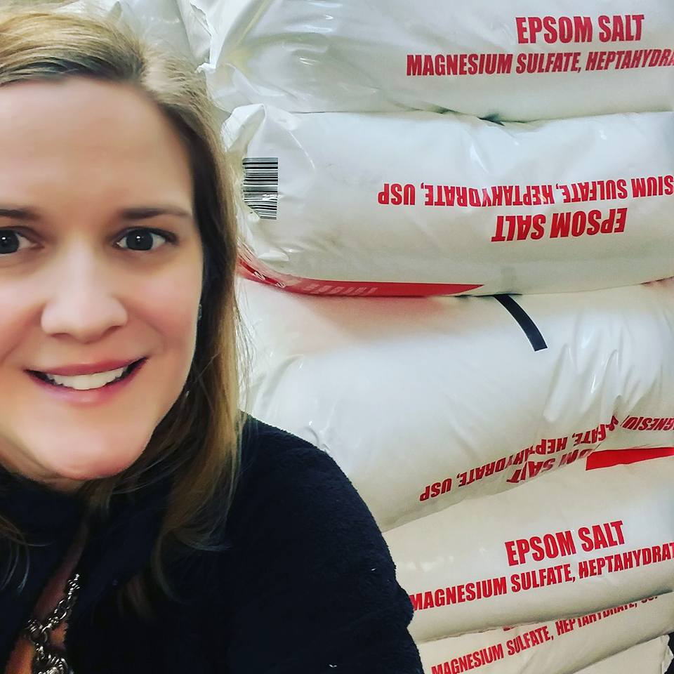 Dr. Melissa demonstrates just some of the bags of salt used when the float pod was delivered.