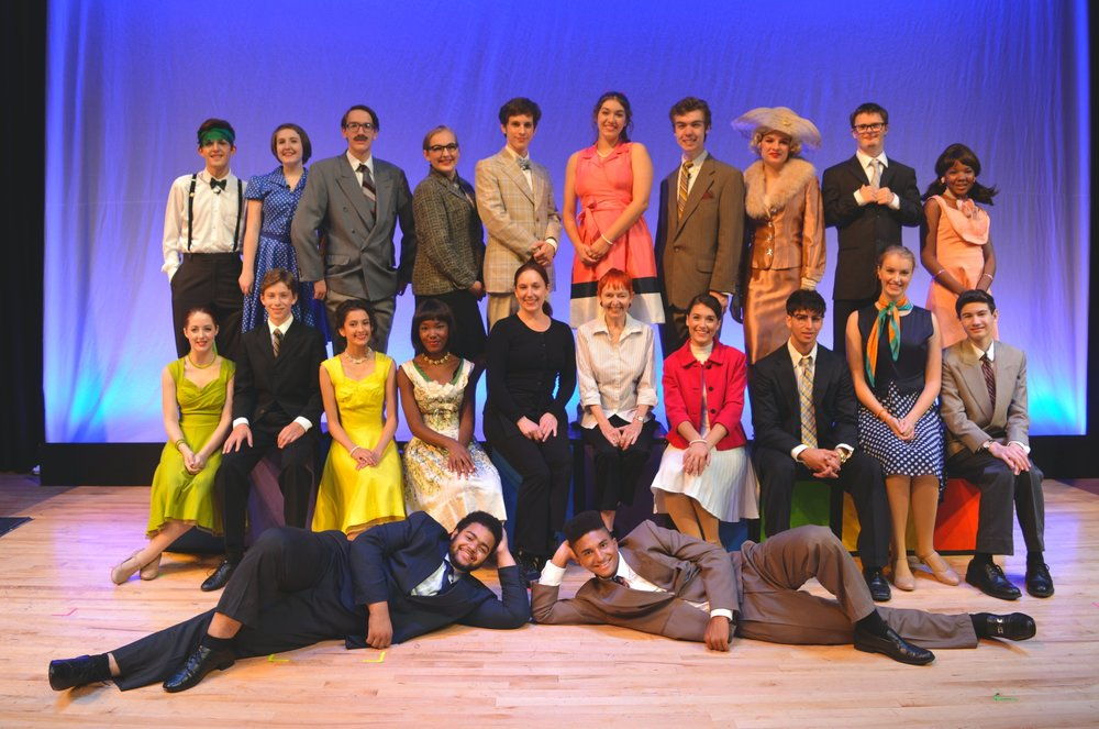 Chrissy, center, with the 2017 Lundstrum cast of  How to Succeed in Business Without Really Trying , which she directed.