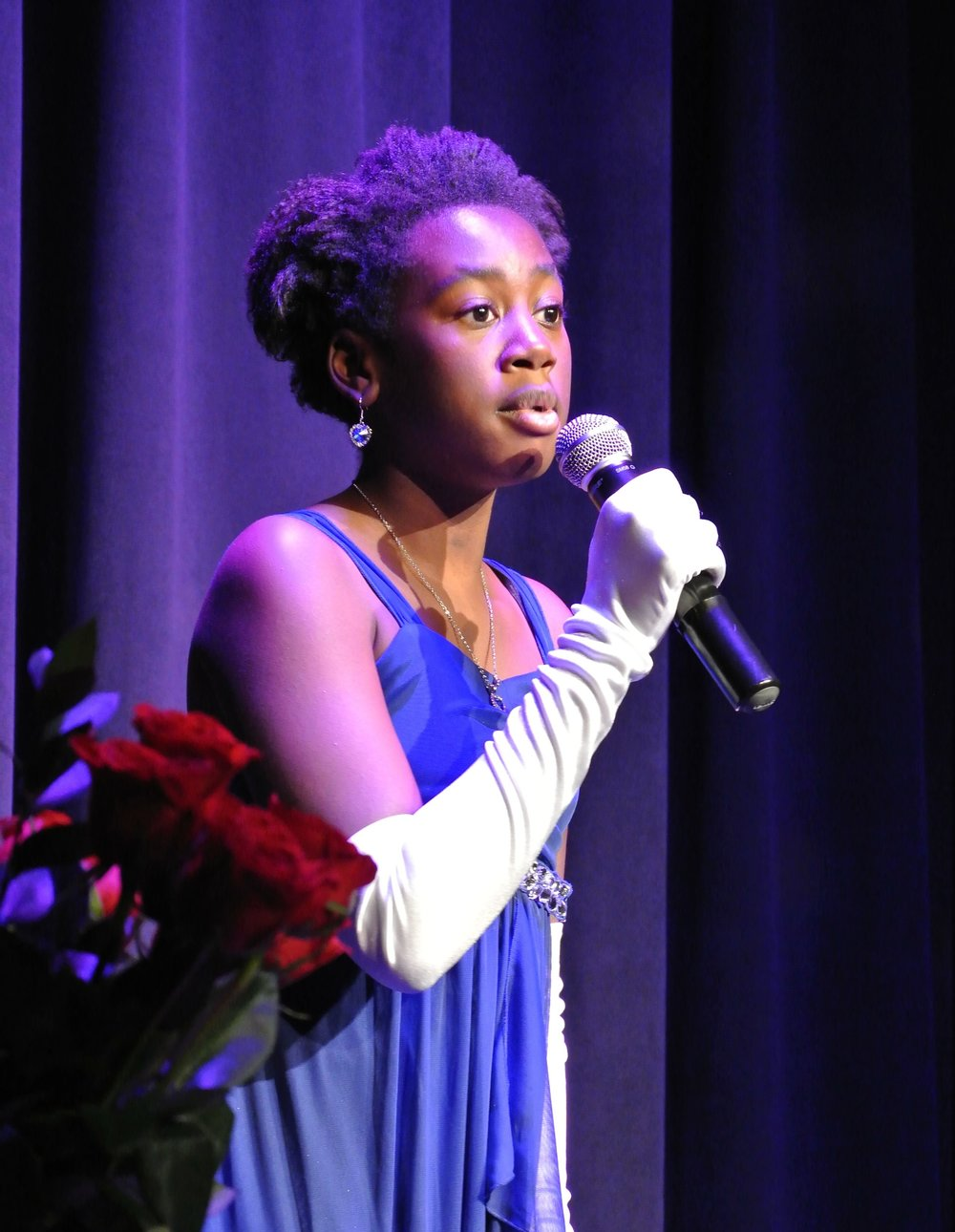 A Lundstrum student performs her solo at the Coffee House Cabaret.
