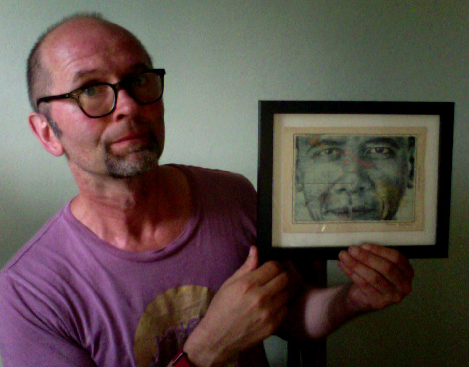 Holding my newly framed portrait of Barack Obama.