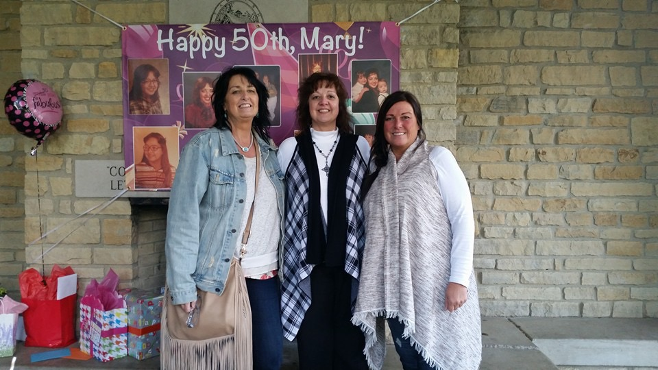 My mom and two of her sisters AND all of her gifts behind them! She definitely got spoiled! Earlier that day, her work threw her a surprise lunch party and made her the cute banner! This lucky lady got two surprise parties in one day!