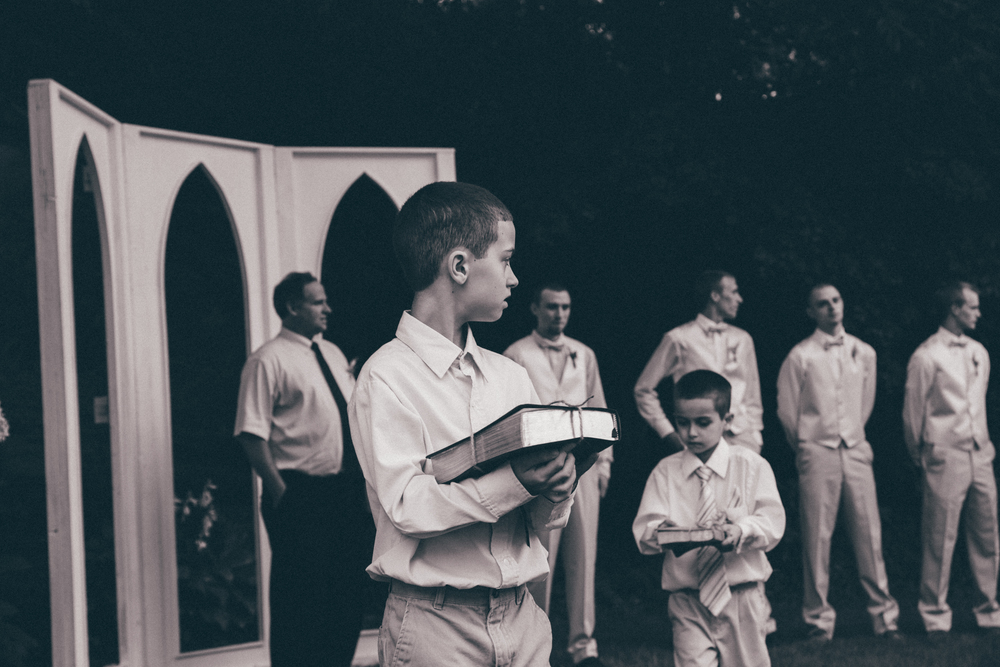Our faith is the foundation of our lives and our marriage. Instead of ring pillows, our Ring Bearers carried our rings tied onto our Bibles. See more personal ideas likes this on the One Weddings Pinterest board:https://www.pinterest.com/oneweddings1/wedding-ideas/  Photo Credit: Matthew Garsky and Alec Fritz Photography