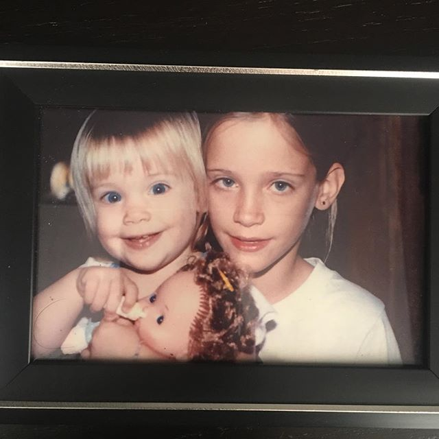 """#tbt my big sister, Camille, an evidently-parched doll, and me. Even though I have spent my entire existence feeling like I don't belong and am very much on the outside of general humanity, I've still dared to wake up (most days) and be myself.  I don't think I'd be able to do this if I hadn't grown up with a confidant/defender/role model in my corner—literally since the day I was born. (And before, if you count the letters Camille wrote to """"new baby,"""" welcoming me into the world.) I spent my childhood being made to feel """"part of"""" by her—building forts, wearing matching outfits, and knowing she would come hug me whenever I was sent to my room (which was often—I am and have been both very stubborn and verbal since the age of"""