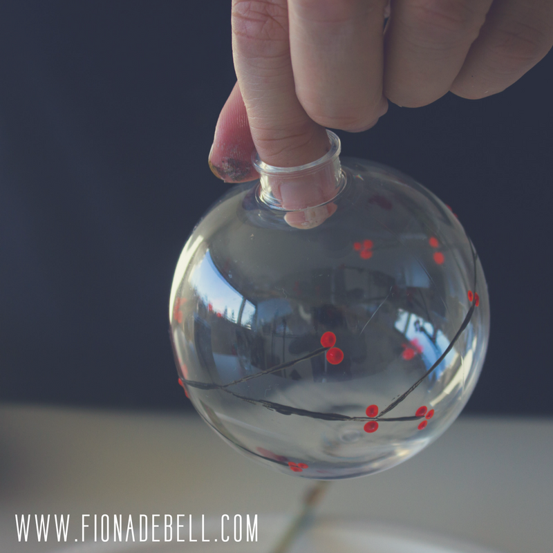 Clear bauble with berries painted on it. | fionadebell.com