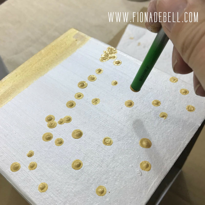 Apply gold paint in random dots to the tissue box.  |  fionadebell.com