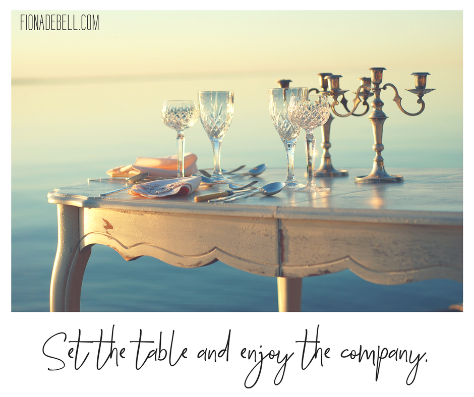 Fiona Debell photographs her dining table outdoors in evening sun. | fionadebell.com