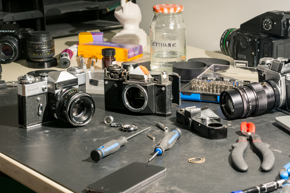 The restored E & Helios 44 on the left, with the donor EM still in pieces to its right