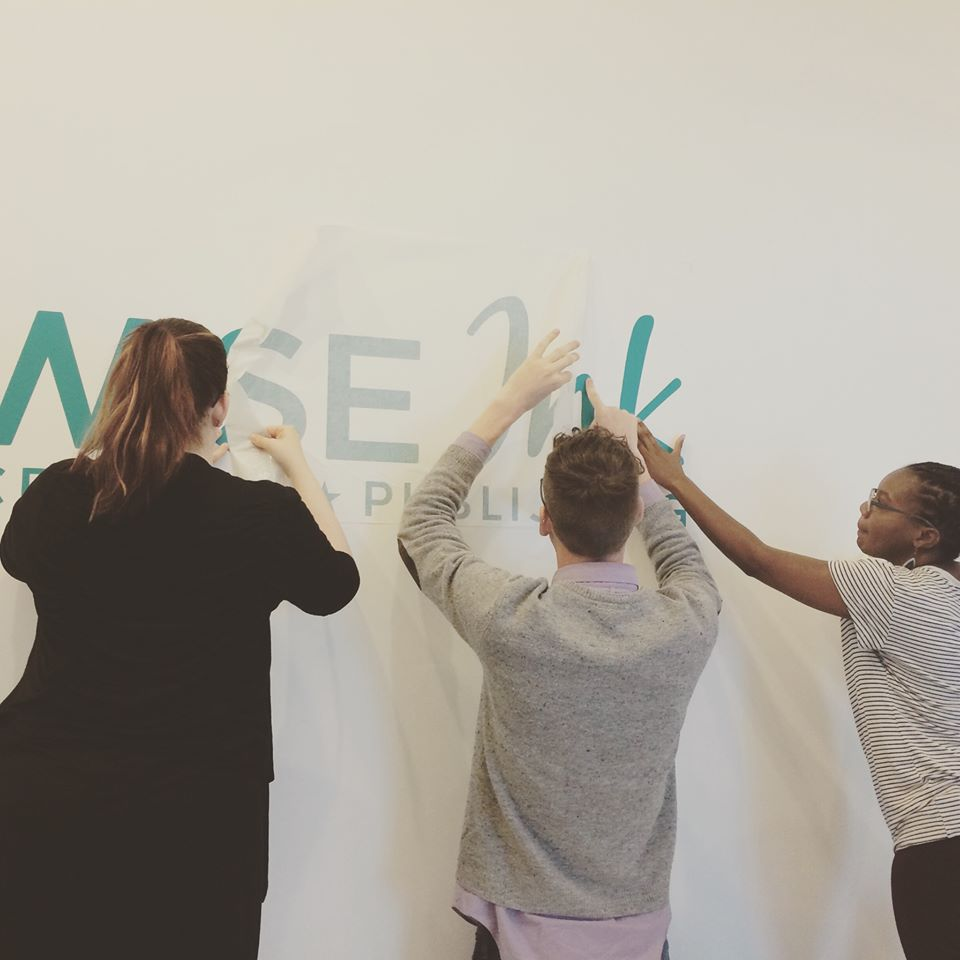 Laura, Patrick, and Dara unveiling the new Wise Ink sign in the new digs.