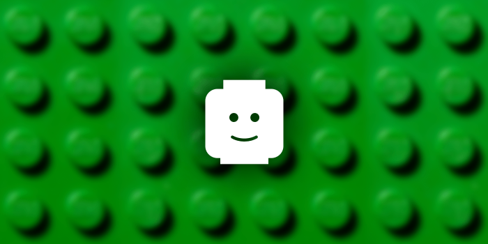 An icon of a Lego minifigure head against a background of lego.