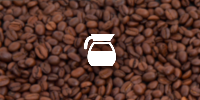 coffee pot icon on a roasted coffee bean background