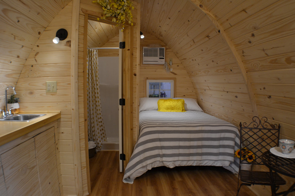 Perfect for 2... - We we do a full bathroom with shower build we recommend configuring the pod for couples.  If you need to accommodate 4 a fold out will fit in place of the table and chairs.