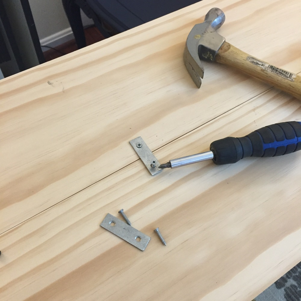 "*Tip, when adding wood screws without using a drill, you can use a hammer and nail a little ""starter hole"" to help hold the screw in place!"