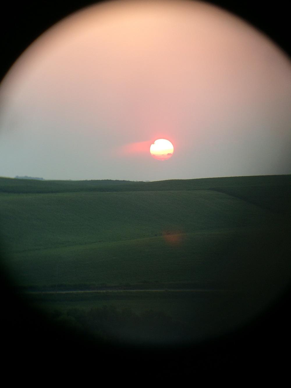 A beautiful Nebraska sunset, while watching a bean field.