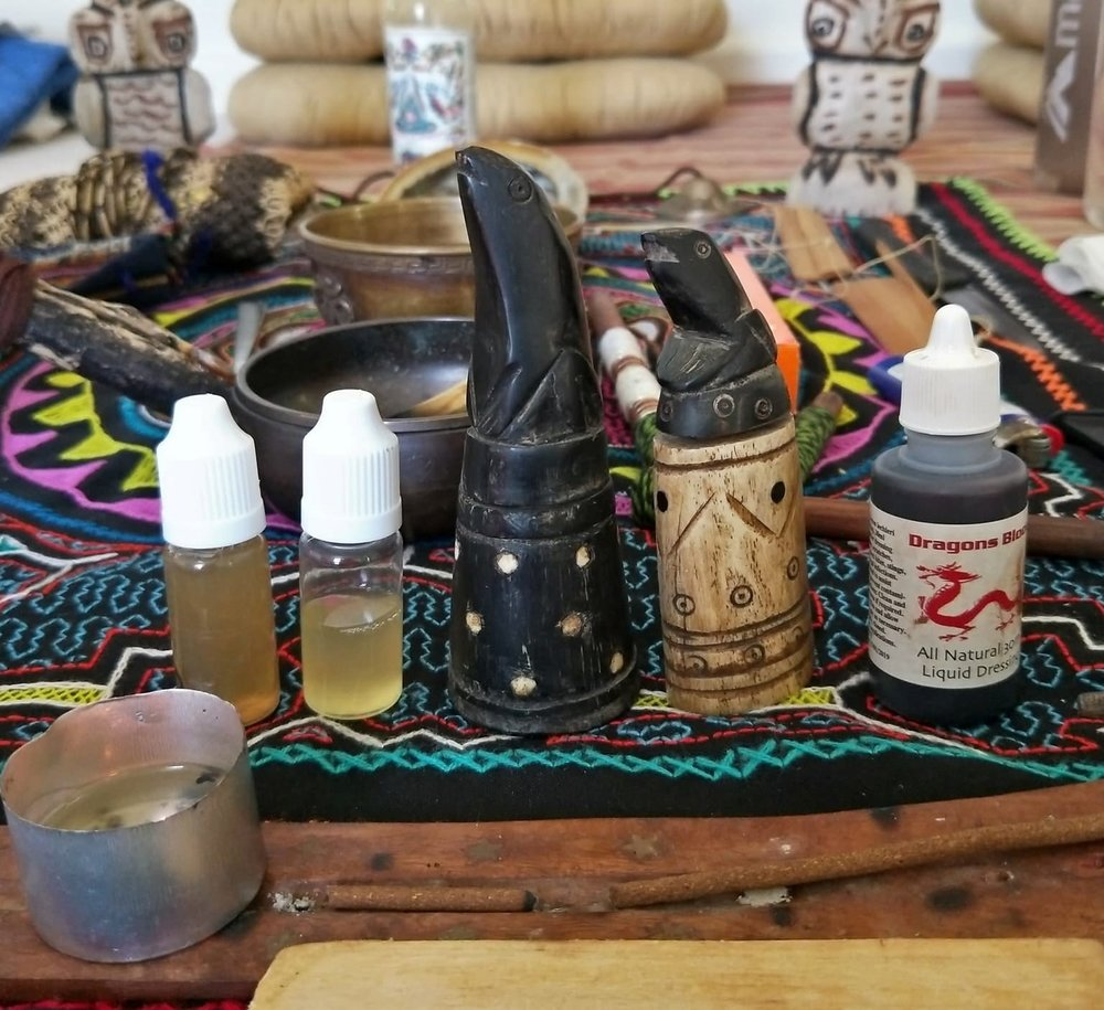 Sananga eye drops pictured in the two bottles to the left. The darker liquid: diluted with colloidal silver, used to uplift and cleanse after Kambo treatments.