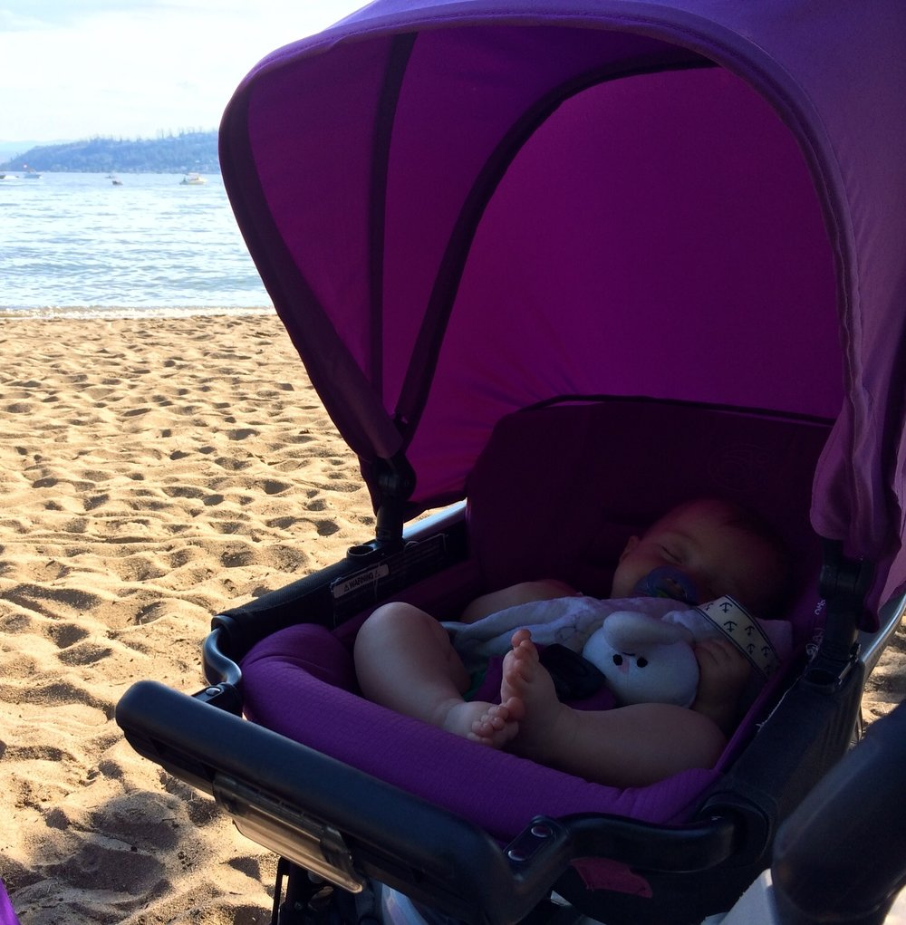 Getting some beauty rest and quiet time at the beach in the AMAZING Orbit Baby Stroller.
