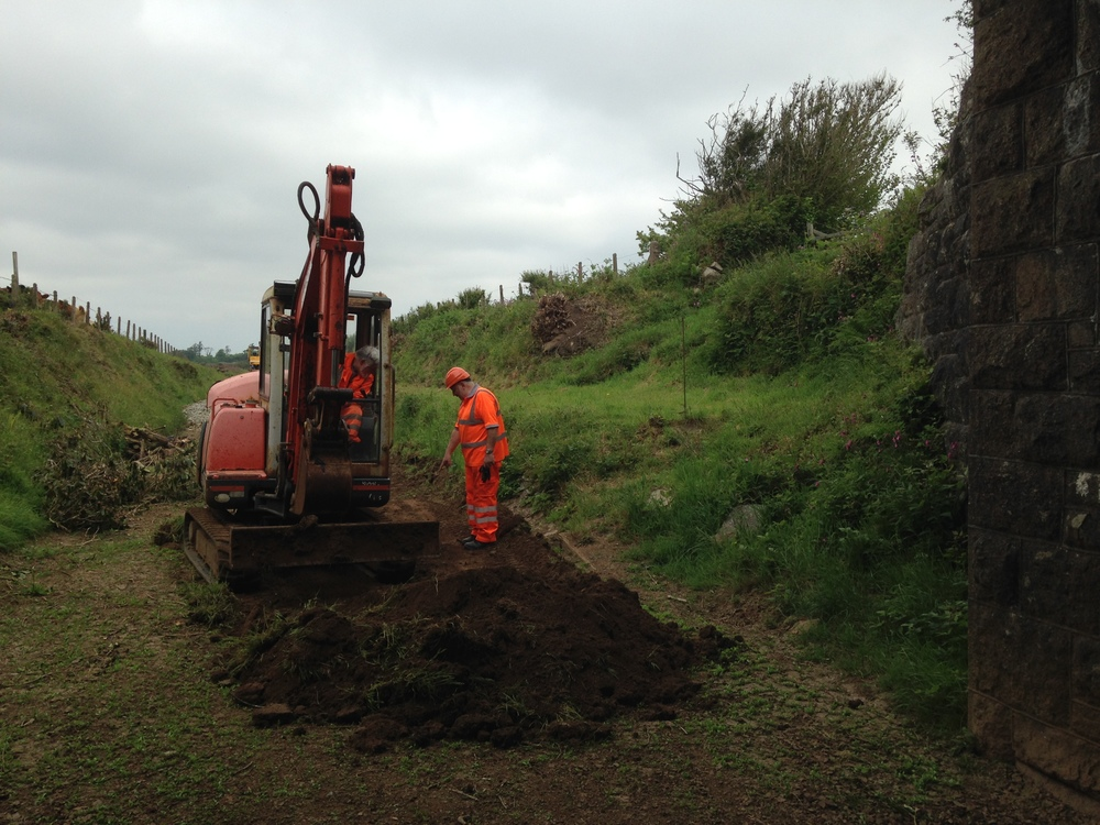 2nd June 2016 - Excavations for a drainage ditch to prevent flooding under the bridge.  Trevor in the cab - Wayne in control.