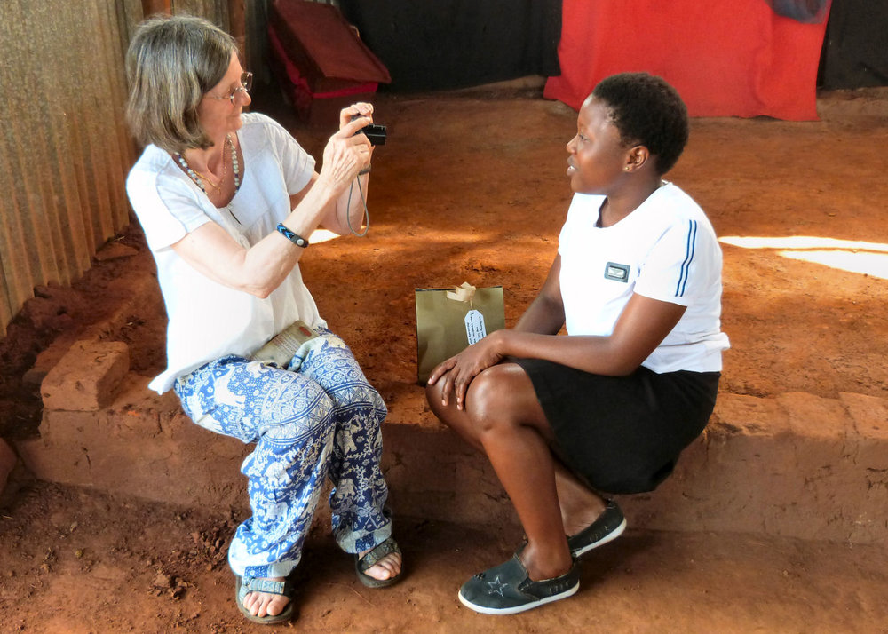 Sue taking a video message from a sponsored student