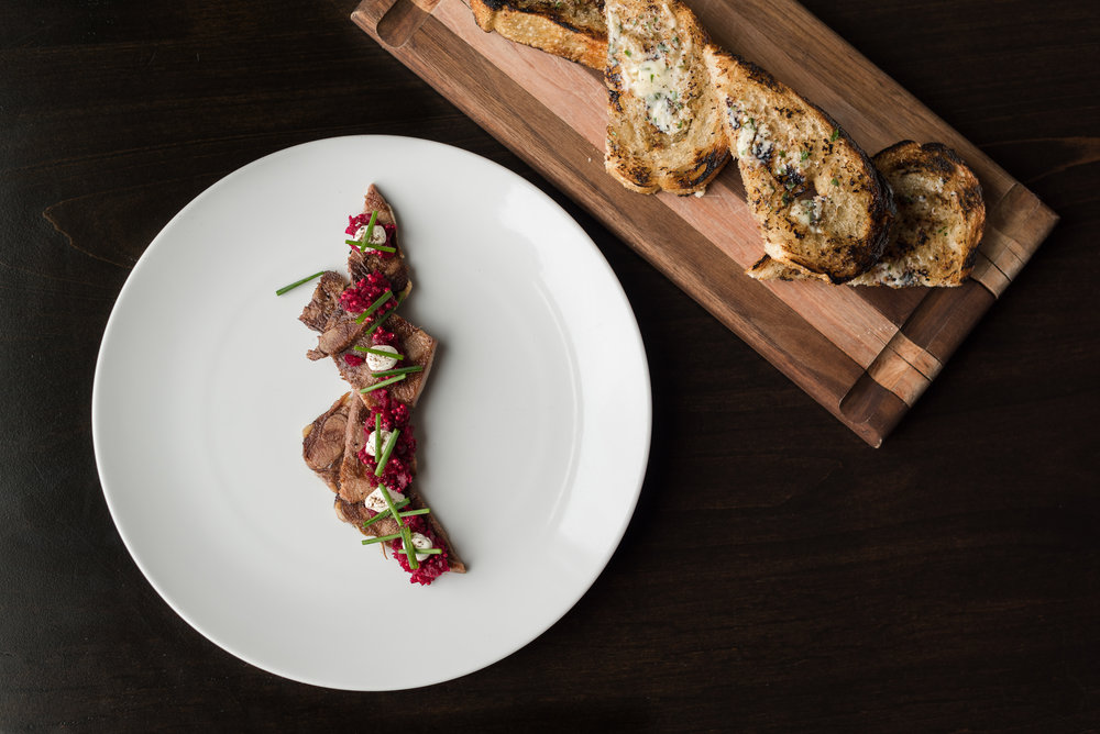 Grilled beef tongue with pickled beet relish, parsley and marrow toast